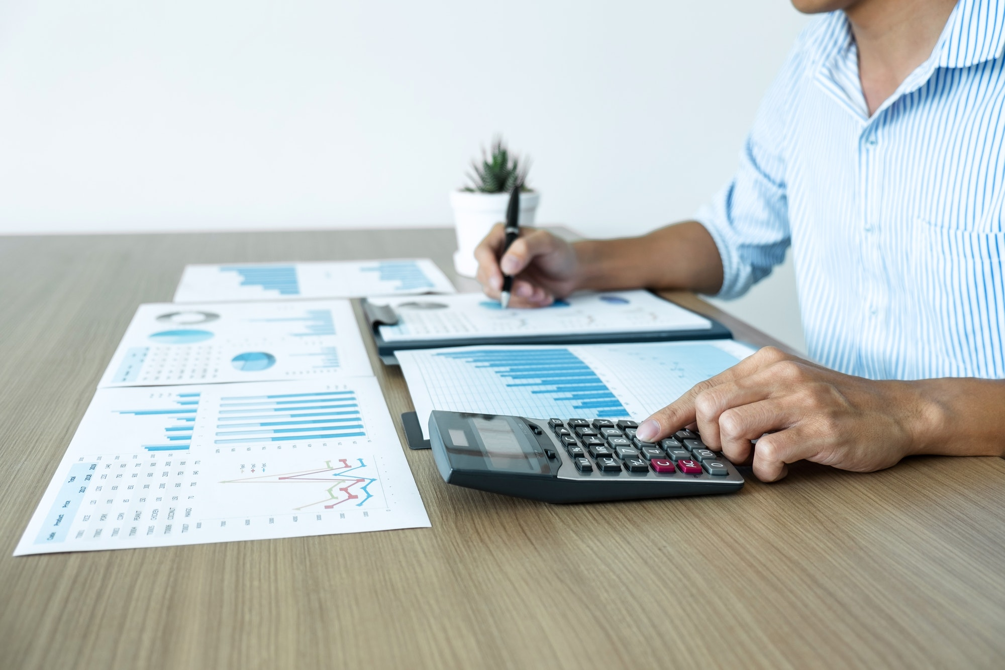 Businessman accountant making working audit and calculating expense financial annual financial