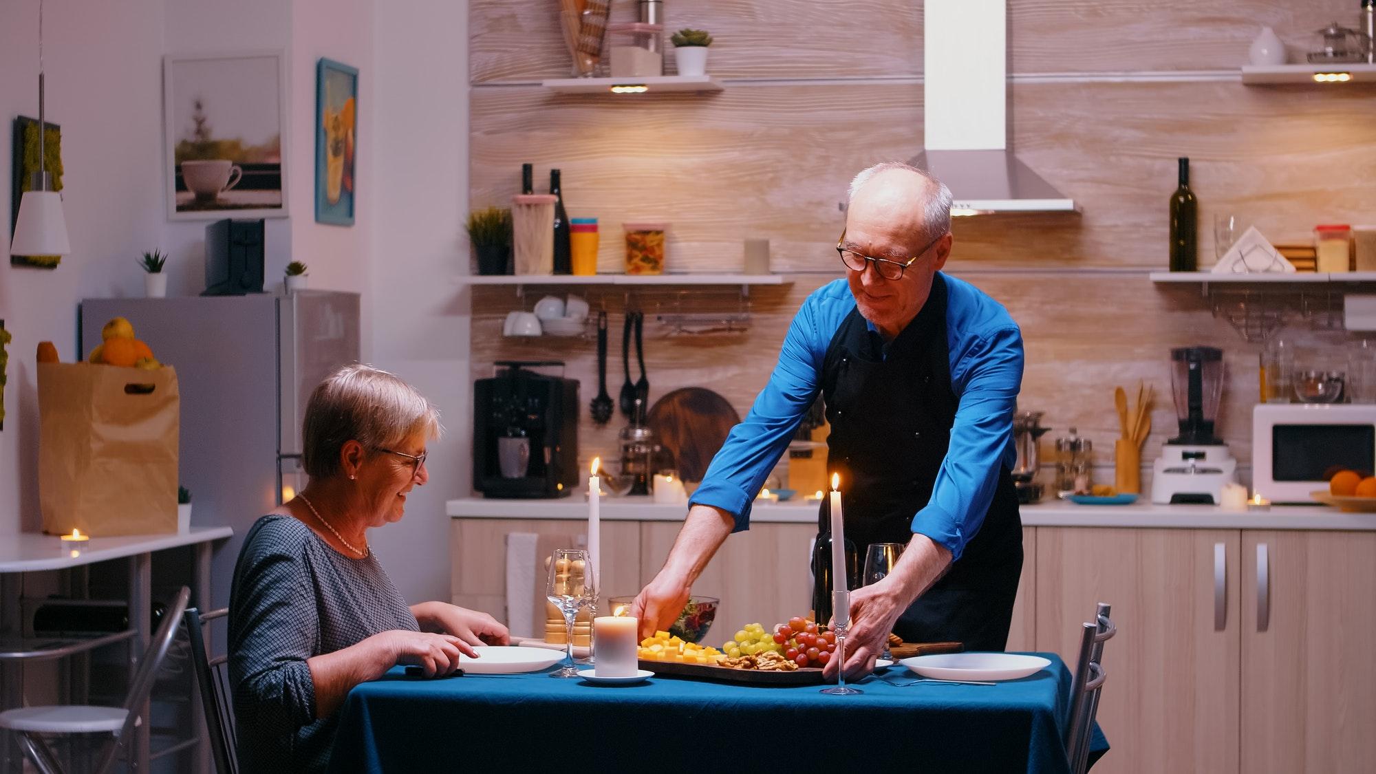 Retirement man surving dinner